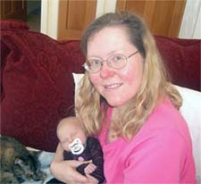 Clara and me, 4 days after she was born.